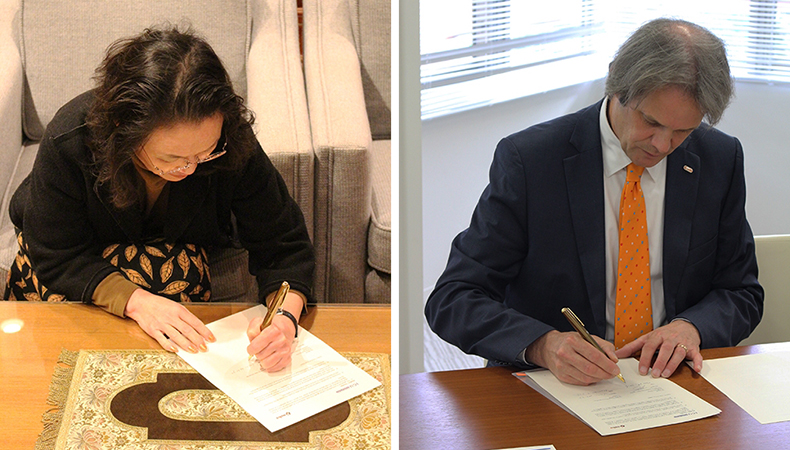 ICU President Junko Hibiya (on left) and NOHA President Joost Herman signing the agreement